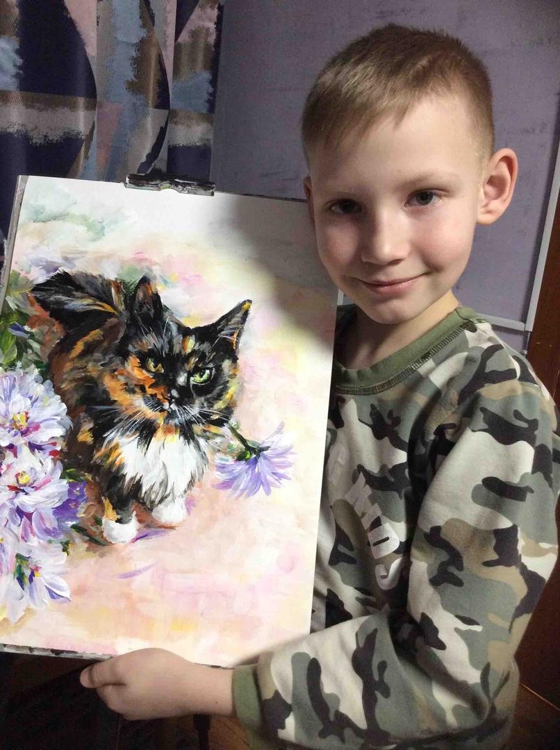 Niño y pintura hecha por él
